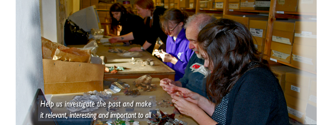 A group of GGAT volunteers of various ages sorting and recording pottery